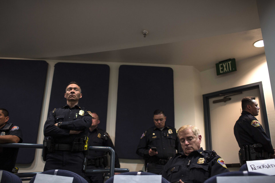 Photo - Albuquerque police chief Gorden Eden sits in audience during a city council meeting in Albuquerque, N.M., Thursday, May 8, 2014. At least seven people were removed from the chambers and given a criminal trespass notice saying not to return to council chambers for 90 days. The Albuquerque City Council gathered Thursday under new rules and heightened security designed to avoid an angry confrontation like the one that broke out earlier in the week amid community outrage over a spate of deadly police shootings. (  (AP Photo/Juan Antonio Labreche)