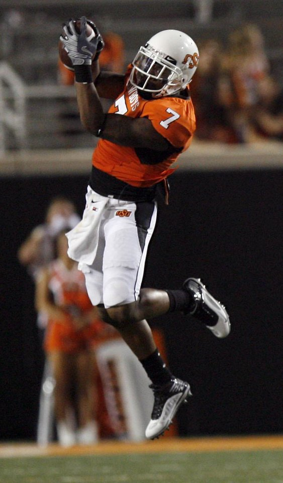 Photo - Oklahoma State wide receiver Michael Harrison (7) catches a pass during the college football game between the University of Tulsa (TU) and Oklahoma State University (OSU) at Boone Pickens Stadium in Stillwater, Oklahoma, Saturday, September 18, 2010. Photo by Sarah Phipps, The Oklahoman
