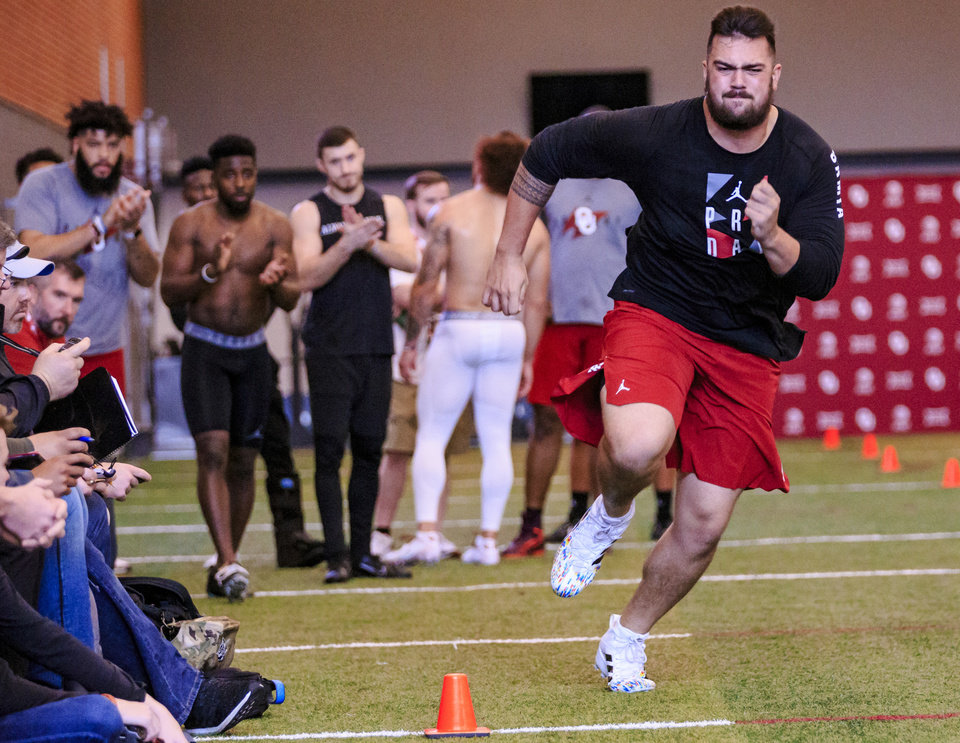 Photo - Dru Samia runs the shuttle drill as he works out for NFL scouts during the University of Oklahoma football pro day at the University of Oklahoma in Norman, Okla. on Wednesday, March 13, 2019.   Photo by Chris Landsberger, The Oklahoman