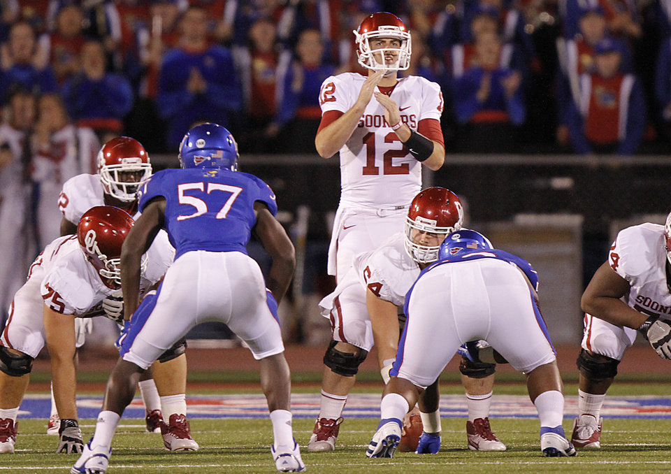 Photo - Oklahoma's Landry Jones (12) calls for a time out during the college football game between the University of Oklahoma Sooners (OU) and the University of Kansas Jayhawks (KU) on Saturday, Oct. 15, 2011. in Lawrence, Kan. Photo by Chris Landsberger, The Oklahoman