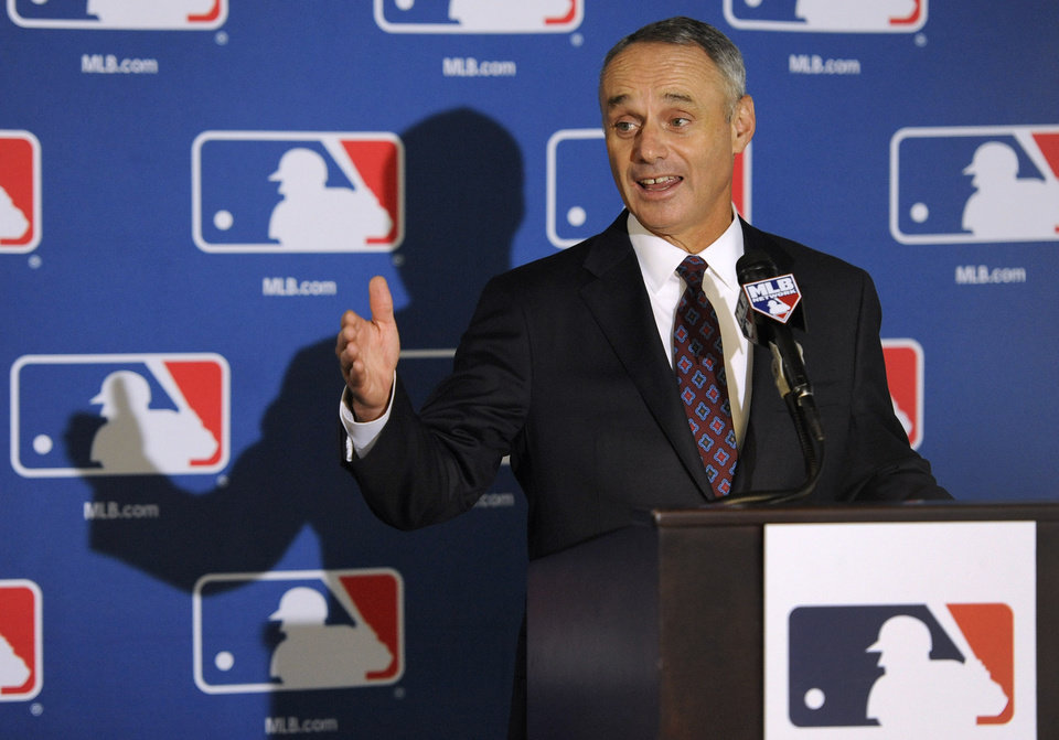 Photo - Major League Baseball Chief Operating Officer Rob Manfred speaks to reporters after team owners elected him as the next commissioner of Major League Baseball during an owners quarterly meeting in Baltimore, Thursday, Aug. 14, 2014. (AP Photo/Steve Ruark)