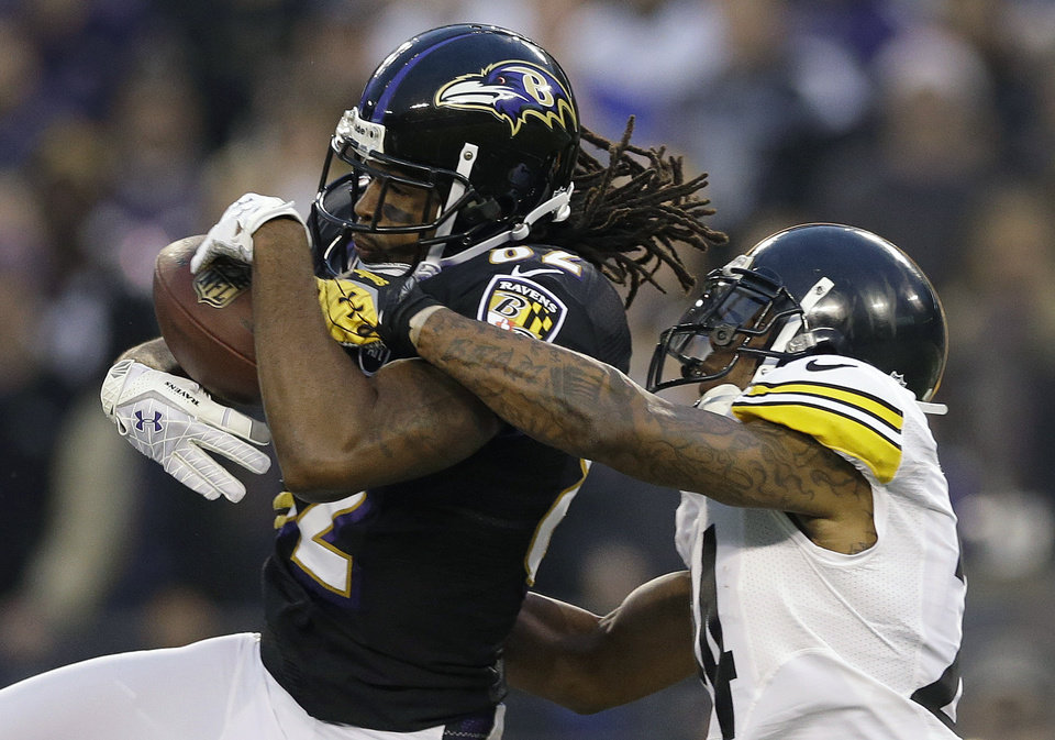 Photo - Pittsburgh Steelers cornerback Ike Taylor, right, breaks up a pass intended for Baltimore Ravens wide receiver Torrey Smith during the first half of an NFL football game in Baltimore, Sunday, Dec. 2, 2012. (AP Photo/Patrick Semansky)