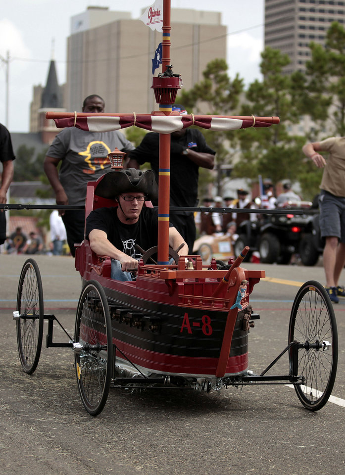Shane Jones races the Ozarka car during Rebuilding Together's ninth annual Construction Derby in Oklahoma City on Sunday. Photo by Sarah Phipps, The Oklahoman <strong>SARAH PHIPPS</strong>