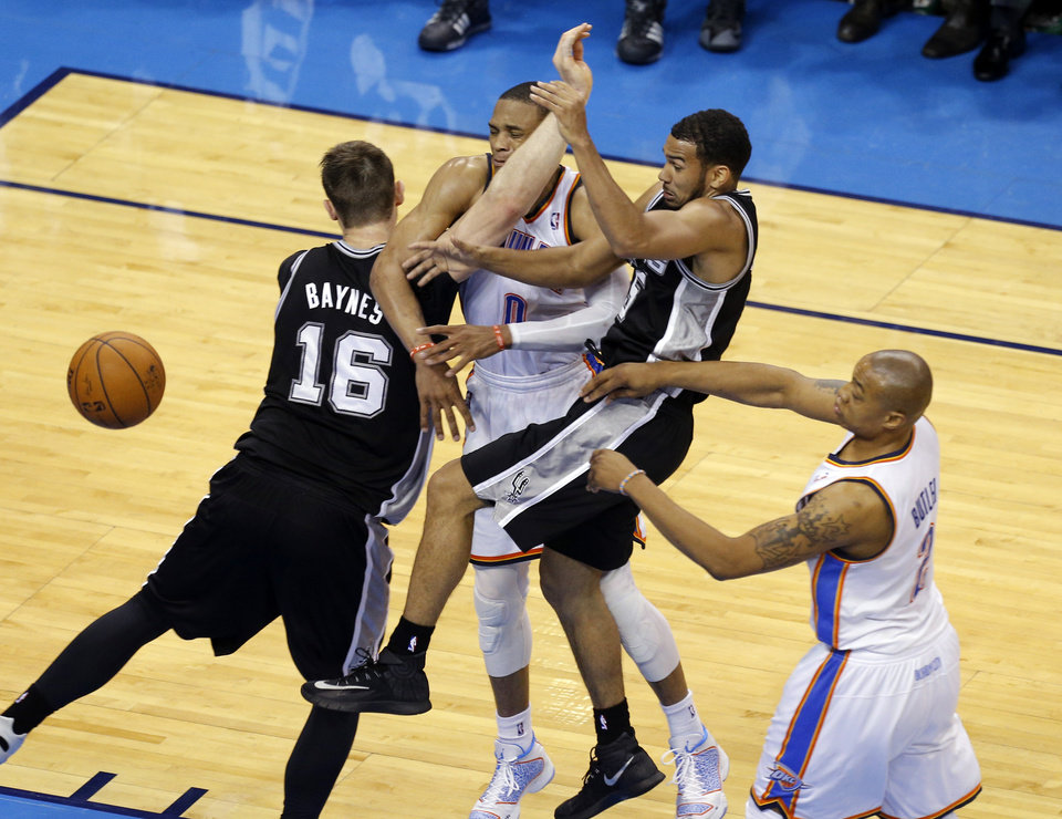 Photo - Oklahoma City's Russell Westbrook (0) gets tangled up with San Antonio's Aron Baynes (16) and Cory Joseph (5) as Oklahoma City's Caron Butler (2) looks on during Game 4 of the Western Conference Finals in the NBA playoffs between the Oklahoma City Thunder and the San Antonio Spurs at Chesapeake Energy Arena in Oklahoma City, Tuesday, May 27, 2014. Photo by Bryan Terry, The Oklahoman