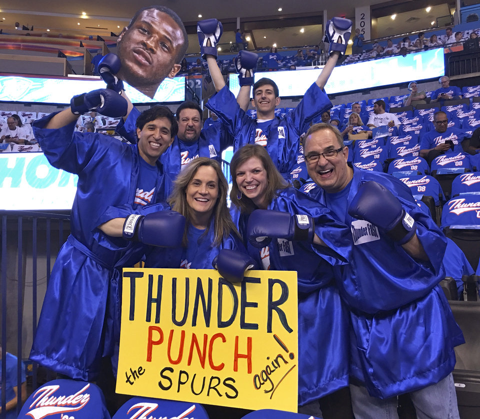 Photo -  Employees, family and friends of Crawford & Associates, an accounting firm in Oklahoma City, dress up for Thunder playoff games. The group sit in section 103, and has been coming up with game themes since the 2012 playoffs. photos provided