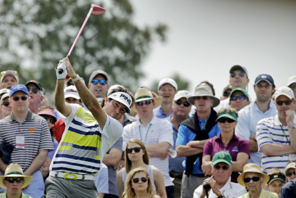 Photo - Bubba Watson tees off on the eighth hole during the second round of the Masters golf tournament Friday, April 11, 2014, in Augusta, Ga. (AP Photo/David J. Phillip)