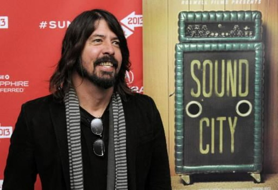 """Photo -  Dave Grohl, director of the documentary film """"Sound City,"""" arrives at the premiere of the film at the 2013 Sundance Film Festival, Friday, Jan. 18, 2013, in Park City, Utah. (AP)"""