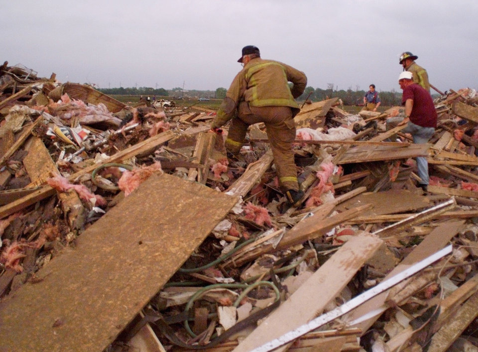 May 3, 1999, Oklahoma City Tornado:  Tornado damage: Rescue workers look through the rubble of a home in the Country Place Estates housing addition SW of 134th and S. Penn. The workers were looking for possible survivors.   Staff Photo by Paul Hellstern