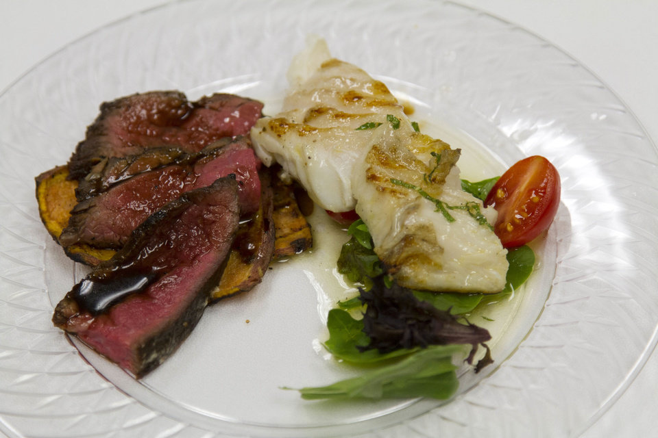 Photo - Chefs Bruce Rinehart and Sam Fitch served London Broil and Halibut with Island Glaze at the Food Dude's