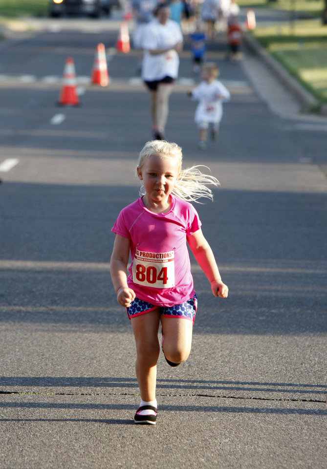 Photo -   Sydney Lucas heads toward the finish line during the family fun run portion of last year's 5K to Monet event in downtown Edmond. Photo by Paul Hellstern, The Oklahoman Archives   PAUL HELLSTERN -  Oklahoman