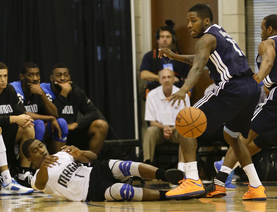 Orlando Magic's Doron Lamb (1) passes the ball as he falls backward past Oklahoma City Thunder's Dwight Bucks, right, during an NBA summer league basketball game, Monday, July 8, 2013, in Orlando, Fla. (AP Photo/John Raoux) ORG XMIT: DOA105