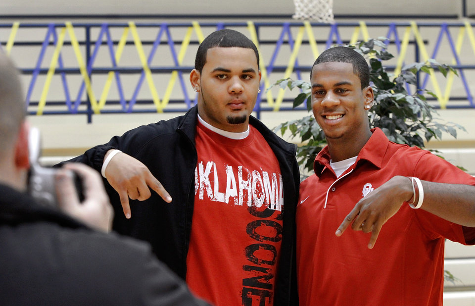 Austin Haywood, left, and teammate Julian Wilson pose for a picture before signing letters of intent with the University of Oklahoma . About a dozen Southmoore High School athletes signed letters of intent with colleges in and out of Oklahoma during a ceremony in the school's gymnasium Wednesday morning, Feb, 3, 2010.  Photo by Jim Beckel, The Oklahoman