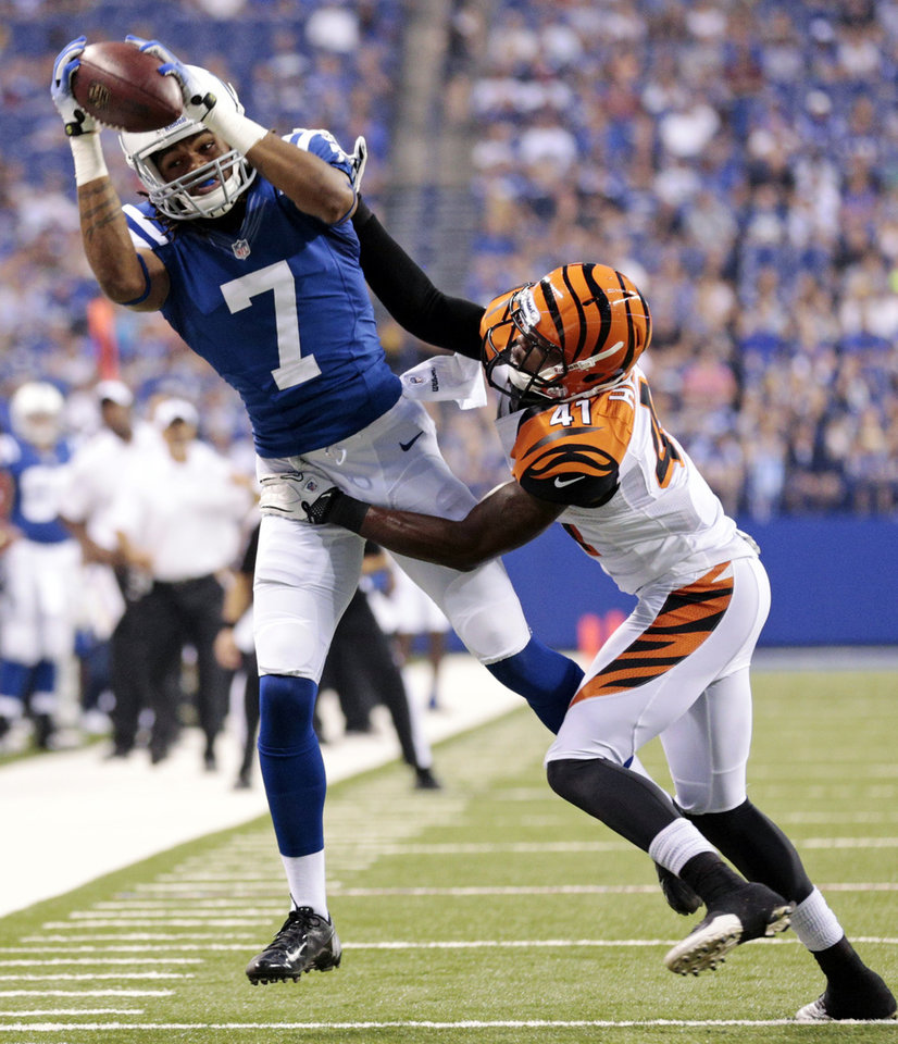 Photo -   Indianapolis Colts wide receiver Kris Adams (7) makes a catch over Cincinnati Bengals defensive back T.J. Heath in the first half of an NFL preseason football game in Indianapolis, Thursday, Aug. 30, 2012. (AP Photo/AJ Mast)