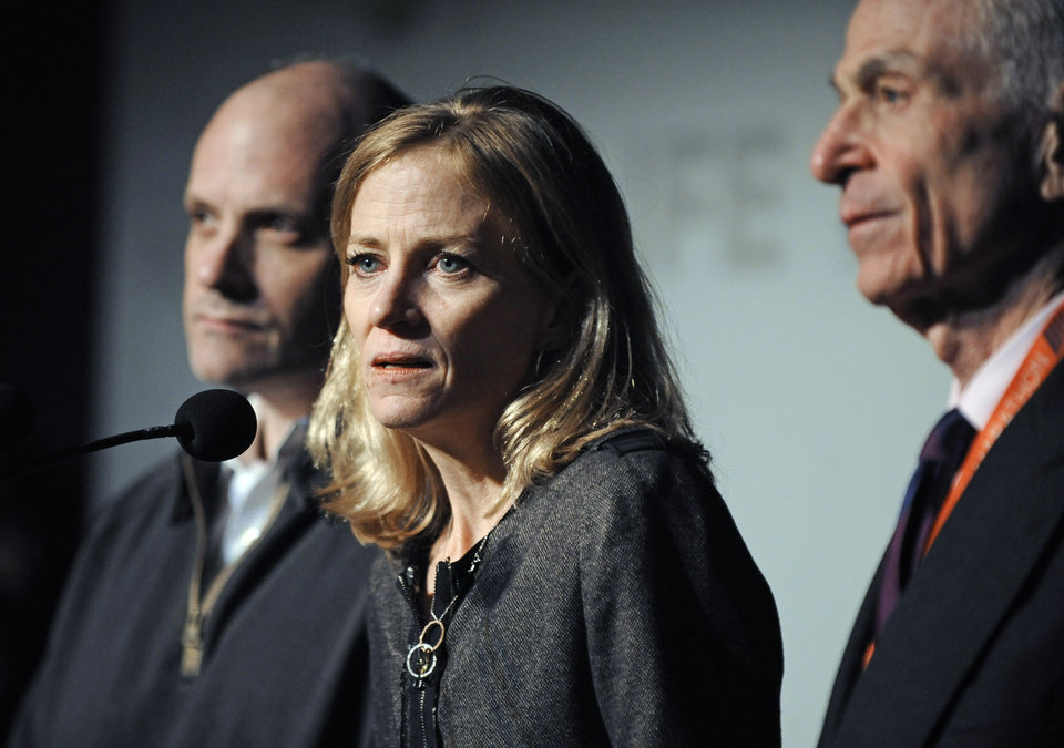 Mary Wittenberg, president of the New York Road Runners, speaks during a news conference Friday, Nov. 2, 2012, in New York, after New York Mayor Michael Bloomberg canceled Sunday's New York City Marathon. At left is Howard Wolfson, deputy mayor for government affairs and communication; at right is George Hirsch, chairman of the board of New York Road Runners. (AP Photo/ Louis Lanzano)