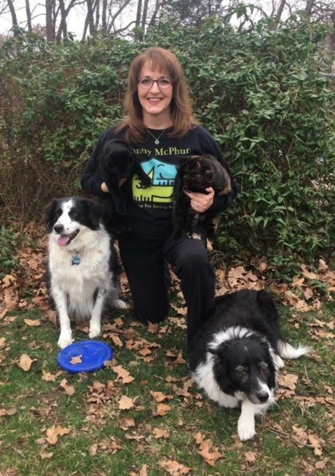 "Photo -  Lori Scott, principal of Edmond-based Nanny McPhur in-home pet-sitting service, poses with her border collies, ""Krystal"" and ""Speedo,"" and cats, ""Foot"" and ""Oliver."" [PHOTO PROVIDED]"