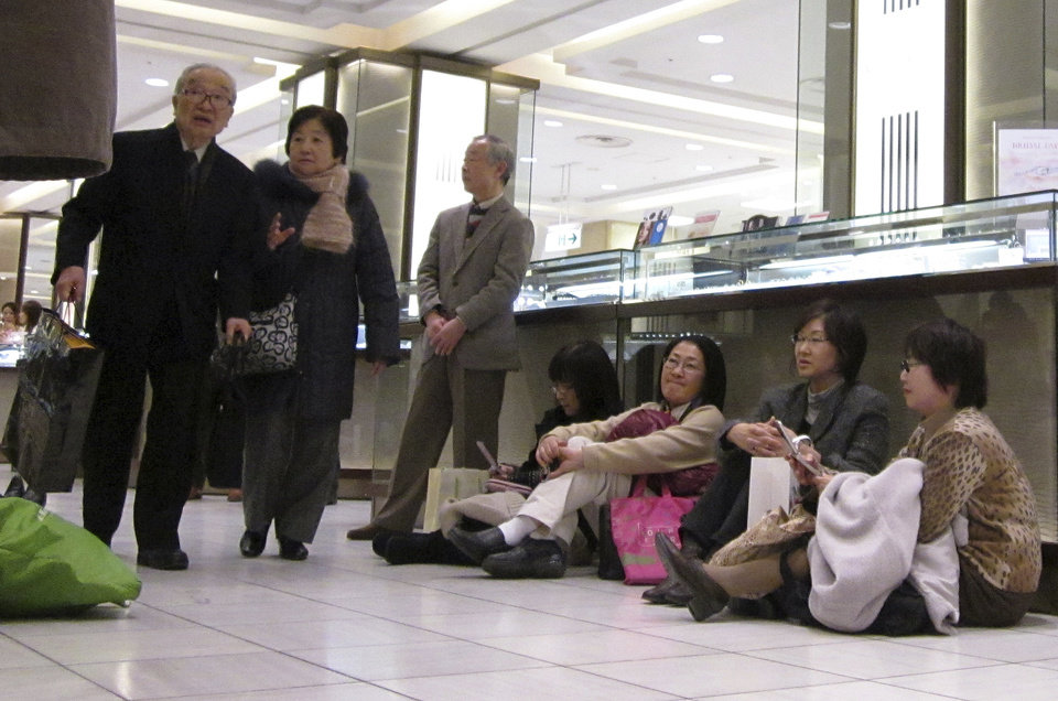 Photo - Some stranded shoppers sit on the floor of a department store as train and bus services were suspended due to a strong earthquake in Yokohama, near Tokyo on Friday, March 11, 2011. (AP Photo/Shuji Kajiyama) ORG XMIT: XKAJ107