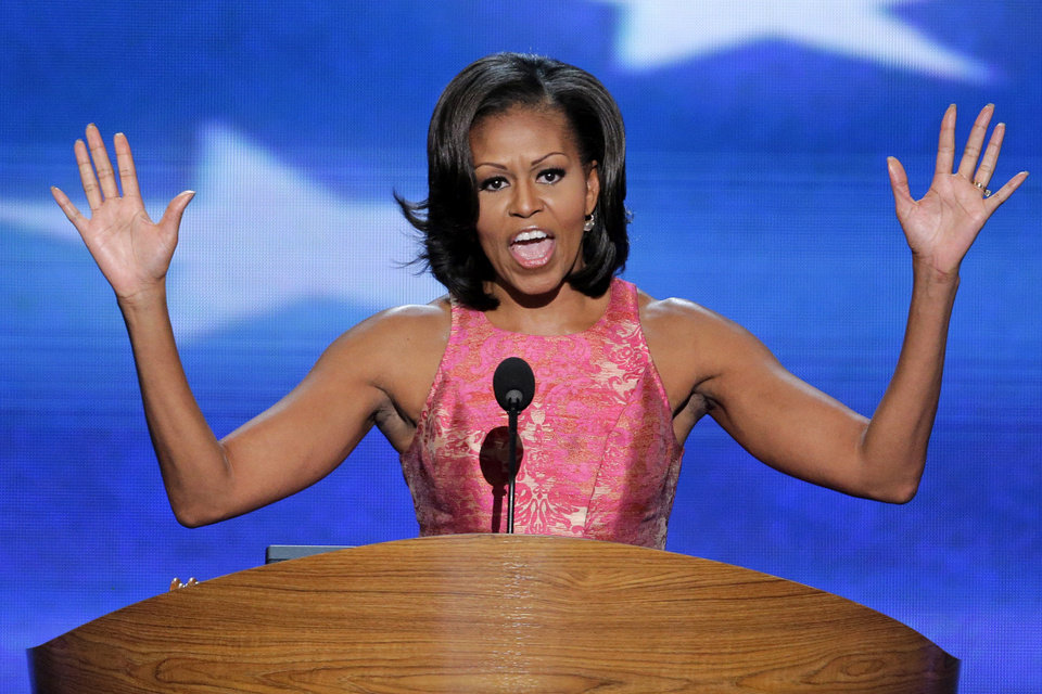 Photo - First Lady Michelle Obama addresses the Democratic National Convention in Charlotte, N.C., on Tuesday, Sept. 4, 2012. (AP Photo/J. Scott Applewhite)  ORG XMIT: DNC195