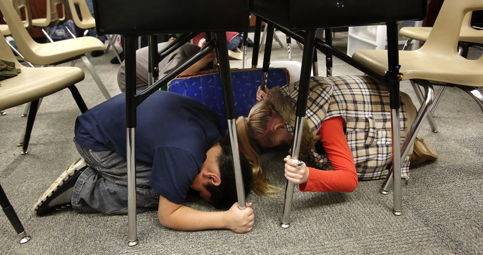 Top: Students take cover in Melinda Jordan's fourth-grade classroom at Cleveland Bailey Elementary. Photos by Jim Beckel, The Oklahoman