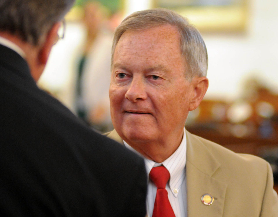Photo - North Carolina State Rep. Frank Iler talks inside the House of Representatives chamber during the first day of the legislative session, Wednesday, May 14, 2014, in Raleigh N.C. (AP Photo/The Star-News, Matt Born)