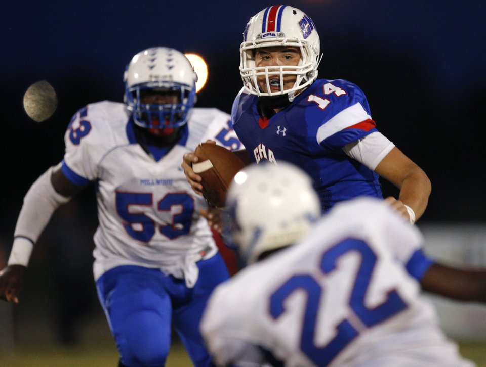 Christian Heritage Academy's Spencer Lindsey scrambles against Millwood during their high school football game at Christian Heritage in Oklahoma City, Friday, Oct. 4, 2013. Photo by Bryan Terry, The Oklahoman