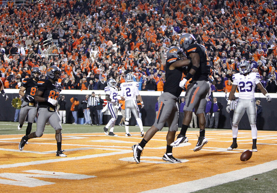 Photo - Oklahoma State's Tracy Moore (87) and Joseph Randle (1) celebrate Randle's game-winning touchdown during a college football game between the Oklahoma State University Cowboys (OSU) and the Kansas State University Wildcats (KSU) at Boone Pickens Stadium in Stillwater, Okla., Saturday, Nov. 5, 2011.  Photo by Sarah Phipps, The Oklahoman
