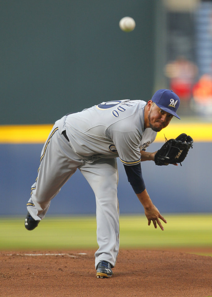 Photo - Milwaukee Brewers starting pitcher Yovani Gallardo delivers in the first inning of a baseball game against the Atlanta Braves on Tuesday, May 20, 2014, in Atlanta. (AP Photo/Todd Kirkland)