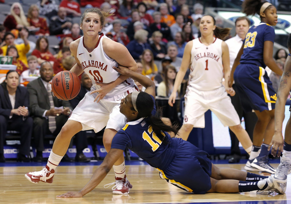 Oklahoma's Morgan hook goes past west Virginia's Darius Faulk during the Big 12 tournament women's college basketball game between the University of Oklahoma and West Virginia at American Airlines Arena in Dallas, Saturday, March 9, 2012. Photo by Bryan Terry, The Oklahoman
