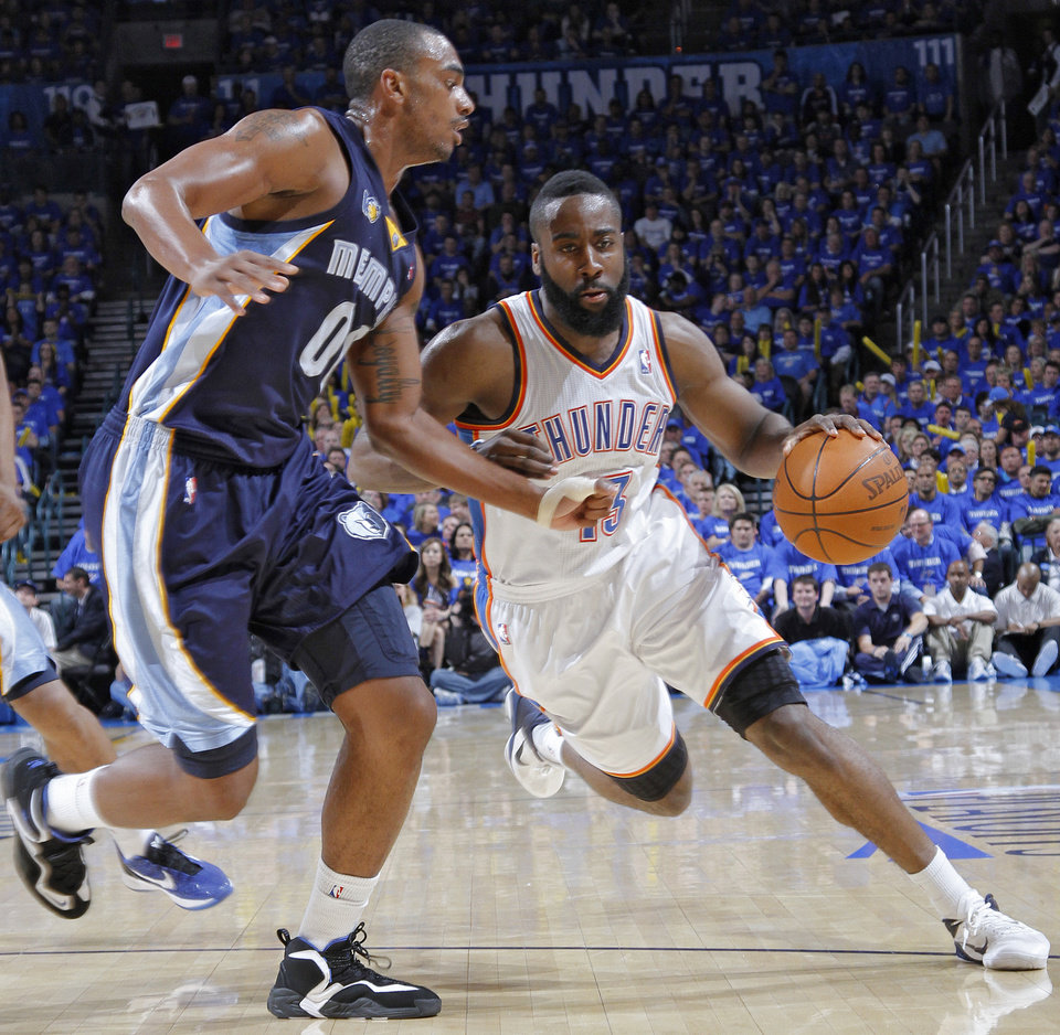 Oklahoma City's James Harden (13) drives past Darrell Arthur (00) of Memphis during game two of the Western Conference semifinals between the Memphis Grizzlies and the Oklahoma City Thunder in the NBA basketball playoffs at Oklahoma City Arena in Oklahoma City, Tuesday, May 3, 2011. Photo by Chris Landsberger, The Oklahoman