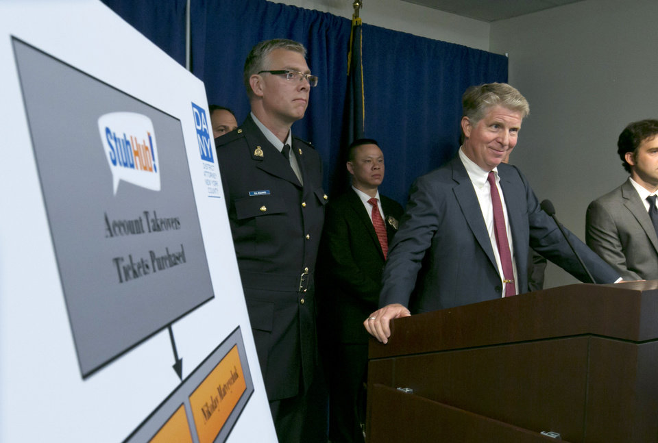 Photo - Manhattan District Attorney Cyrus Vance Jr., right, accompanied by RCMP Sgt. Richard Rollings, left, of London, Ontario,  smiles during a New York news conference, Wednesday, July 23, 2014. Six people were indicted Wednesday in an international ring that took over more than 1,600 StubHub users' accounts and fraudulently bought tickets to such prime events as Jay-Z and Elton John concerts and Broadway shows like
