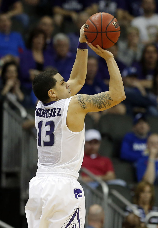 Kansas State's Angel Rodriguez (13) shoots a three-pointer during the Phillips 66 Big 12 Men's basketball championship tournament game between Oklahoma State University and Kansas State at the Sprint Center in Kansas City, Friday, March 15, 2013. Photo by Sarah Phipps, The Oklahoman