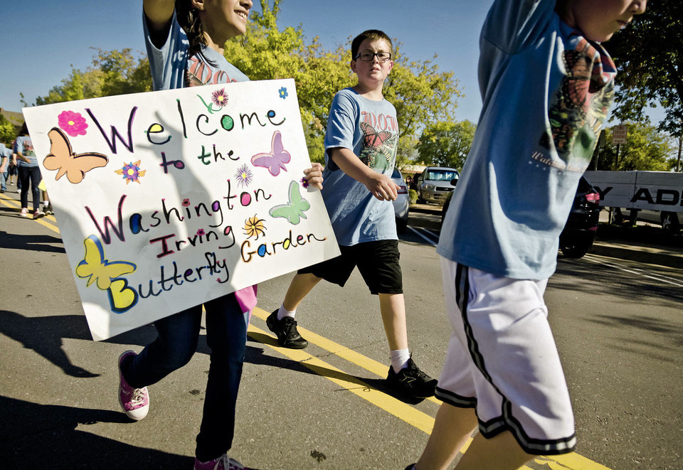 Students from Washington Irving Elementary walk Wednesday during the Edmond Santa Fe High School homecoming parade.  Photo by Chris Landsberger, The Oklahoman