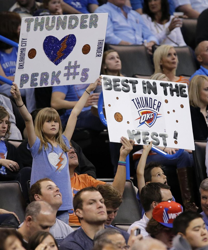 Thunder fans show support for their team during the season finally NBA basketball game between the Oklahoma City Thunder and the Milwaukee Bucks at Chesapeake Energy Arena on Wednesday, April 17, 2013, in Oklahoma City, Okla.   Photo by Chris Landsberger, The Oklahoman