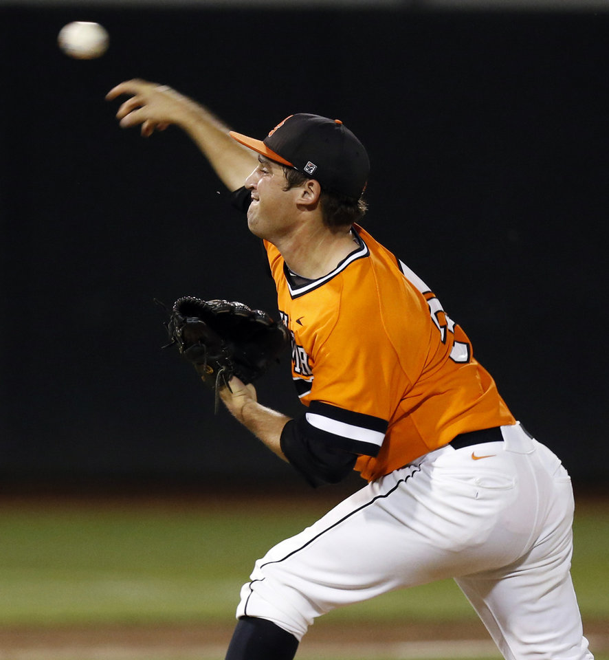Photo - OSU's Vince Wheeland (35) pitches during Game 2 of the NCAA baseball Stillwater Super Regional between Oklahoma State and UC Irvine at Allie P. Reynolds Stadium in Stillwater, Okla., Saturday, June 7, 2014. Photo by Nate Billings, The Oklahoman