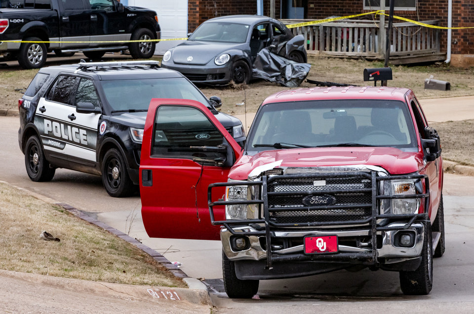 Photo - Emergency crews respond to a scene where the truck that hit six Moore High School students killing one in Moore, Okla. on Monday, Feb. 3, 2020.  [Chris Landsberger/The Oklahoman]