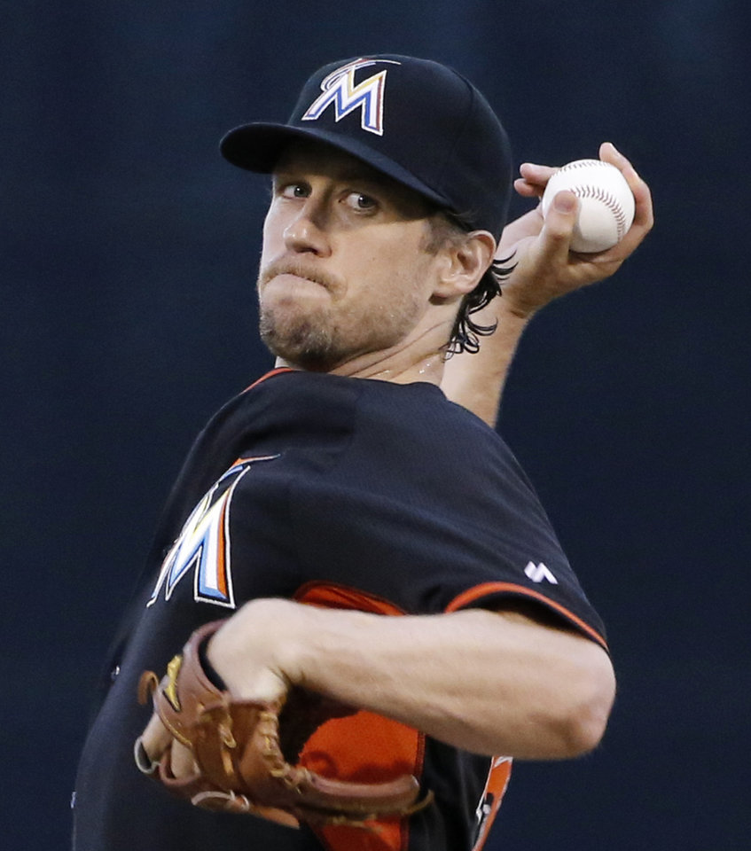 Photo - Miami Marlins starting pitcher Kevin Slowey delivers a warmup pitch before a spring exhibition baseball game against the New York Yankees in Tampa, Fla., Friday, March 28, 2014.  The Yankees defeated the Marlins 3-0. (AP Photo/Kathy Willens)
