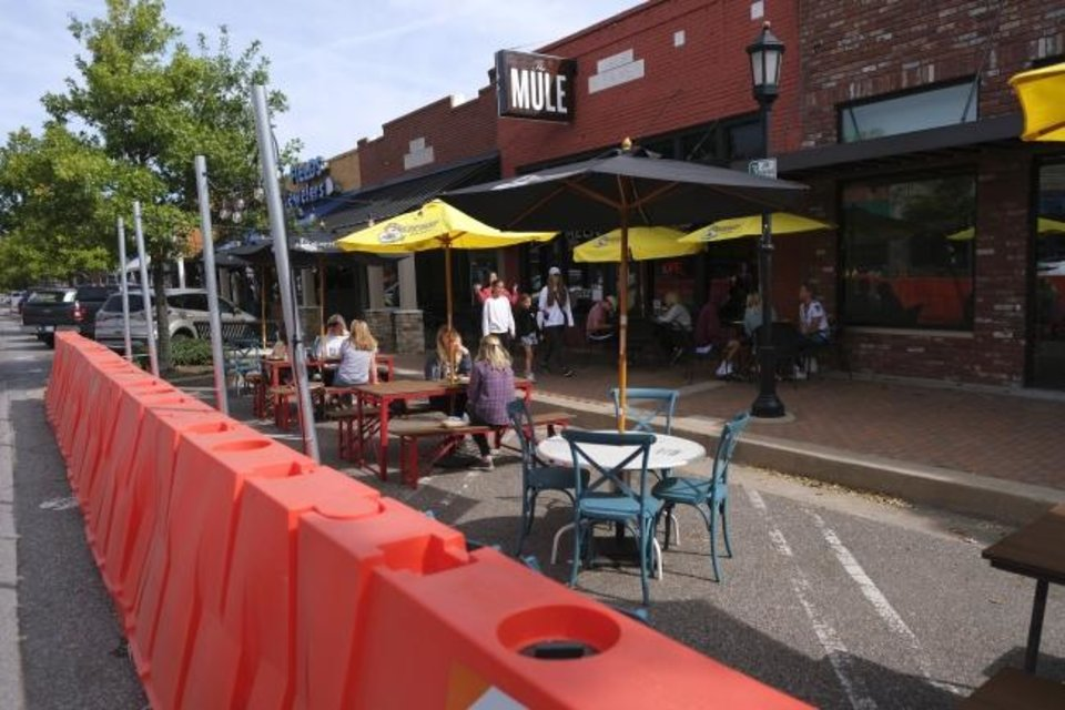 Photo - The Mule. Streateries in downtown Edmond. Restaurants/cafes were allowed  to take over street space to expand their dining options during the pandemic. Thursday, October 15, 2020. [Doug Hoke/The Oklahoman]