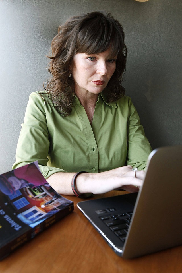 Betsy Randolph, who is getting her first book  published, works on her writing Thursday in Edmond.  Photo By Paul Hellstern, The Oklahoman