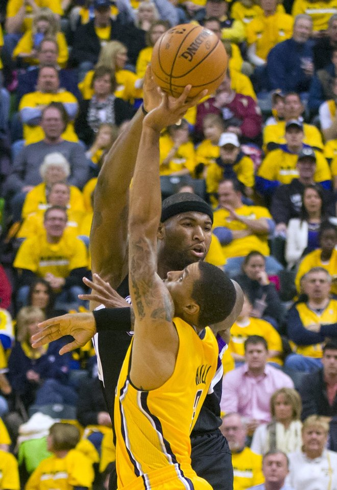 Photo -   Sacramento Kings' DeMarcus Cousins gets pressure from Indiana Pacers' George Hill during the first half of an NBA basketball game in Indianapolis on Saturday, Nov. 3, 2012. (AP Photo/Doug McSchooler)