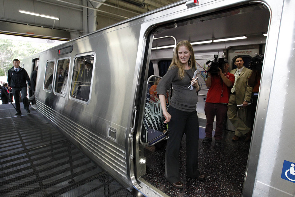 Members of the media try out a door on a full-scale mock-up model of Metro's new generation 7000-series railcar after it was unveiled in Landover, Md., Wednesday, Oct. 10, 2012. (AP Photo/Ann Heisenfelt)