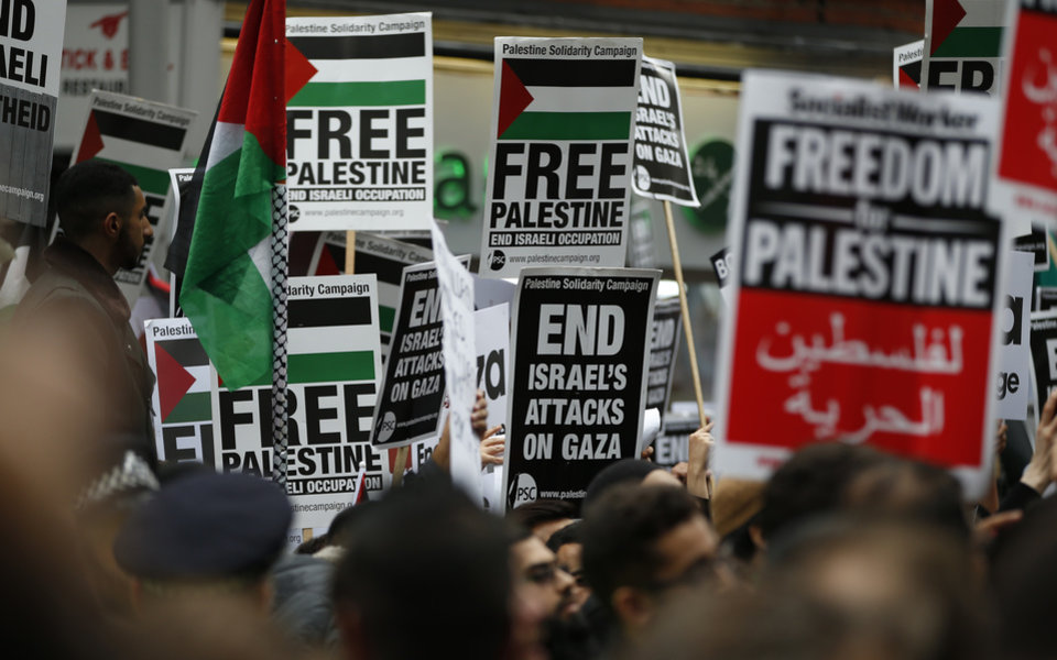 Photo - Demonstrators take part in a protest against action taken by Israel in the Gaza strip near the Israeli embassy in London, Friday, July 11, 2014. Thousands of pro-Palestinian demonstrators turned out on the streets of London and Paris on Friday to call for an end to Israeli military strikes on Gaza. Several thousand people crowded the streets outside the Israeli Embassy in west London, waving placards that read