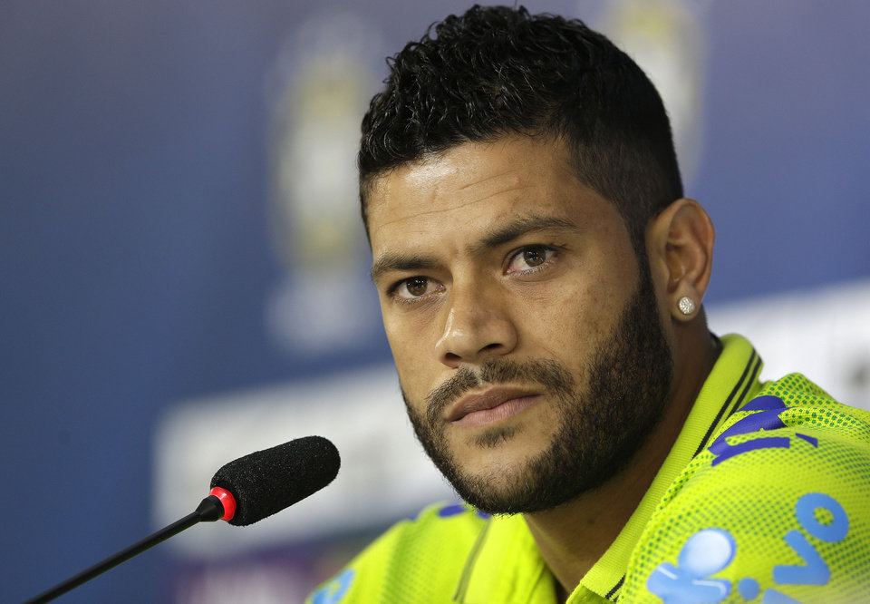 Photo - Brazil's Hulk listens to questions from the media during a news conference after a training session of the Brazilian national soccer team at the Granja Comary training center in Teresopolis, Brazil, Sunday, June 15, 2014. Brazil plays in group A of the 2014 soccer World Cup. (AP Photo/Andre Penner)