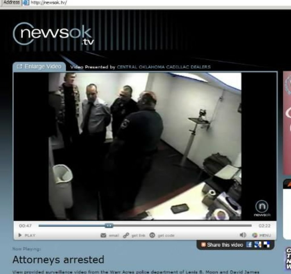 Photo - Screen shot of recording of attorneys' behavior at the Warr Acres police station in 2008 after they were arrested.