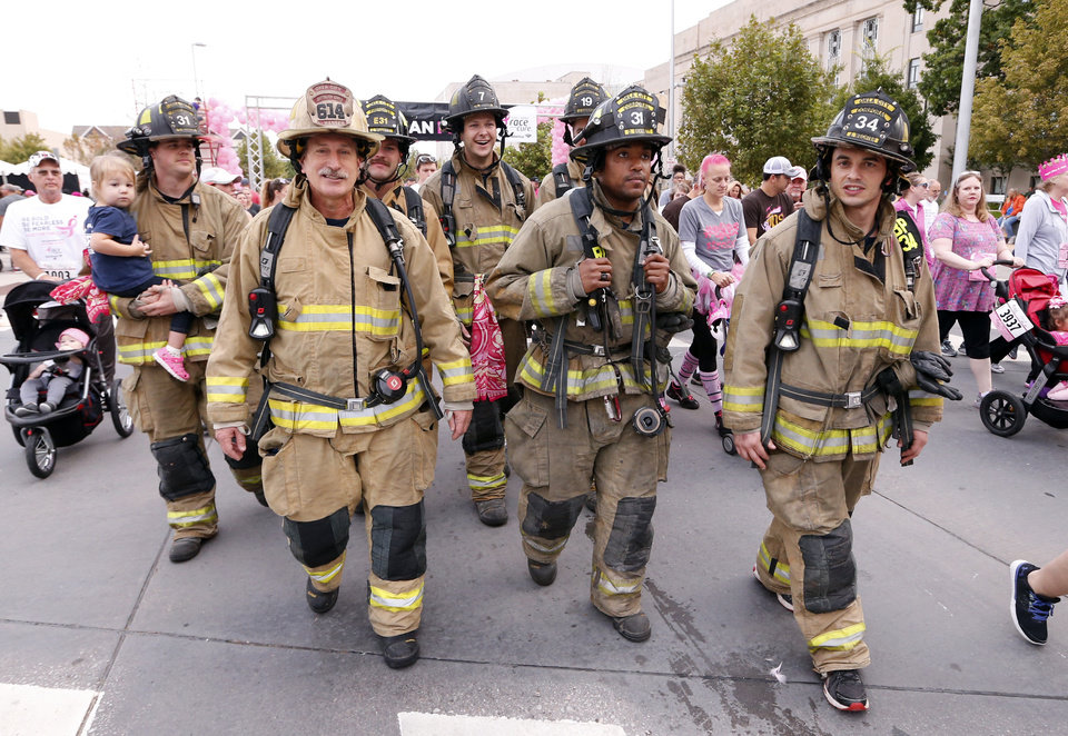 Photo -  Oklahoma City firemen participate in the fun run during the Susan G. Komen Race for the Cure on Saturday. [PHOTO BY STEVE SISNEY, THE OKLAHOMAN]