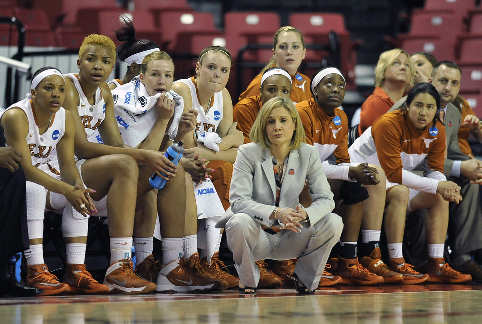 Photo - Texas head coach Karen Aston, front, and her team look on during the first half of the first round of the NCAA women's college basketball tournament game against Penn, Sunday, March 23, 2014, in College Park, Md. (AP Photo/Gail Burton)
