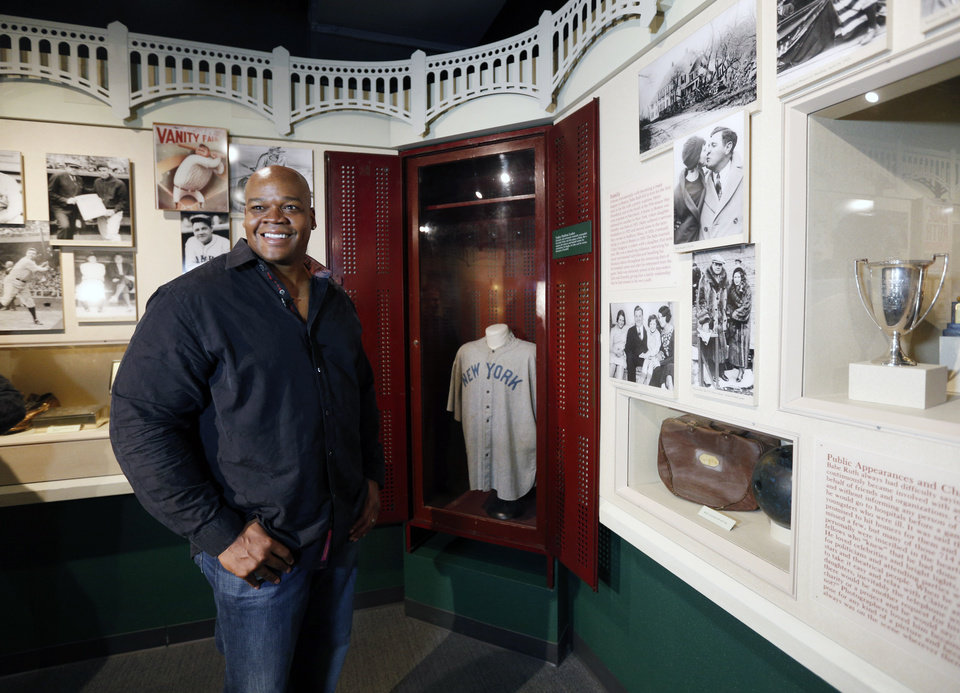 Photo - Former Chicago White Sox player Frank Thomas visits a Babe Ruth exhibition during his orientation visit at the Baseball Hall of Fame on Monday, March 3, 2014, in Cooperstown, N.Y. Thomas will be inducted to the hall in July. (AP Photo/Mike Groll)