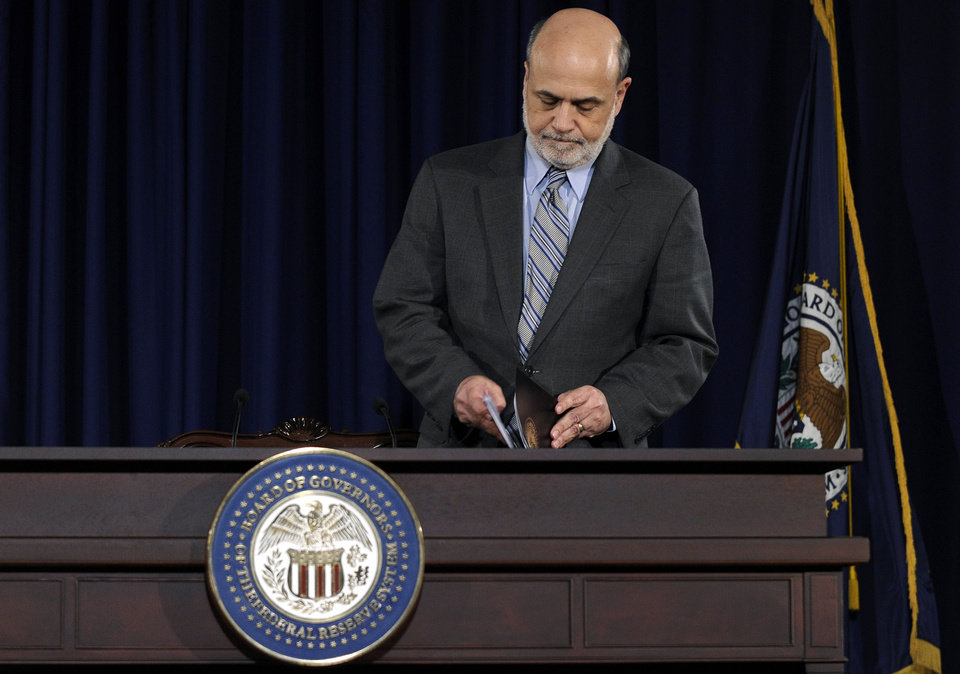 Photo - FILE - In this  Wednesday, Sept. 18, 2013, file photo, Federal Reserve Chairman Ben Bernanke arrives to speak at a news conference at the Federal Reserve in Washington. The Fed surprised just about everyone Wednesday by delaying a slowdown in its $85 billion in monthly bond purchases. The purchases are designed to keep long-term loan rates low to spur borrowing and spending.  (AP Photo/Susan Walsh, File)