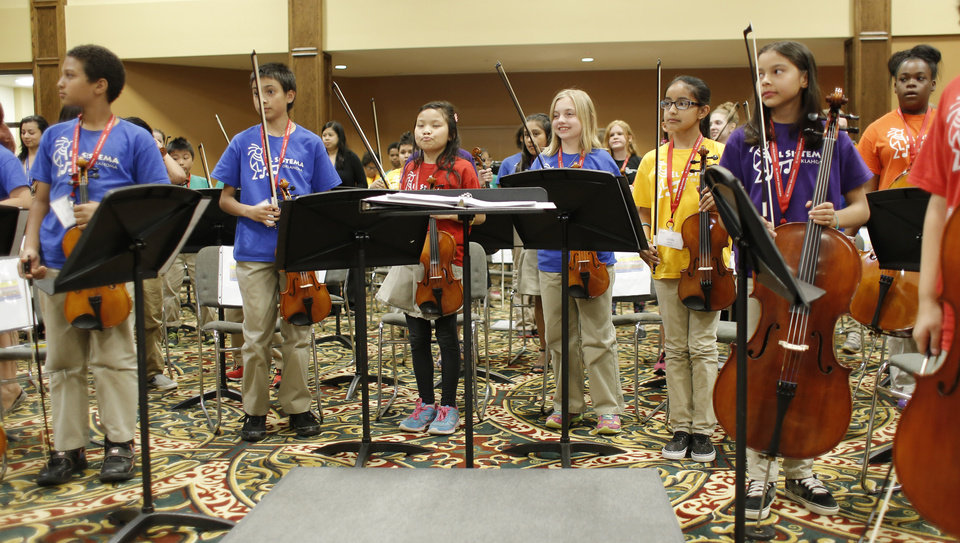 Photo -  Several members of the El Sistema Oklahoma youth orchestra perform during their final concert of the school year at St. Luke's United Methodist Church, 222 NW 15. They are, from left: Jonathan Amukaya, Ricardo Rojas, Anna Van, Lillian Stover, Linda Barrios, Leah White and Maliah Smith. Photo by Doug Hoke, The Oklahoman   DOUG HOKE