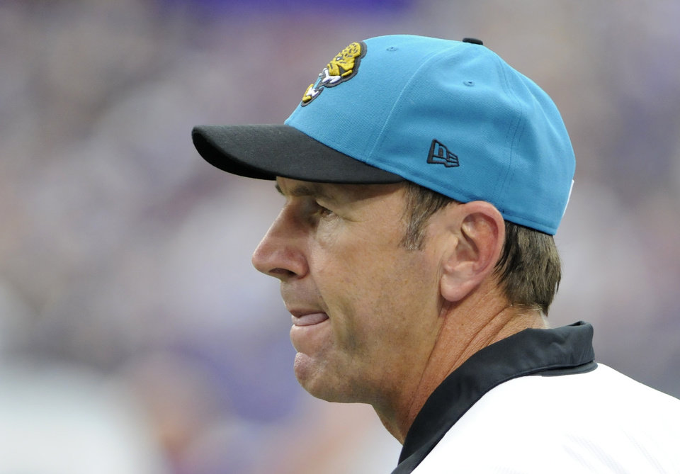 Photo -   Jacksonville Jaguars head coach Mike Mularkey looks on during the first half of an NFL football game against the Minnesota Vikings, Sunday, Sept. 9, 2012, in Minneapolis. (AP Photo/Jim Mone)