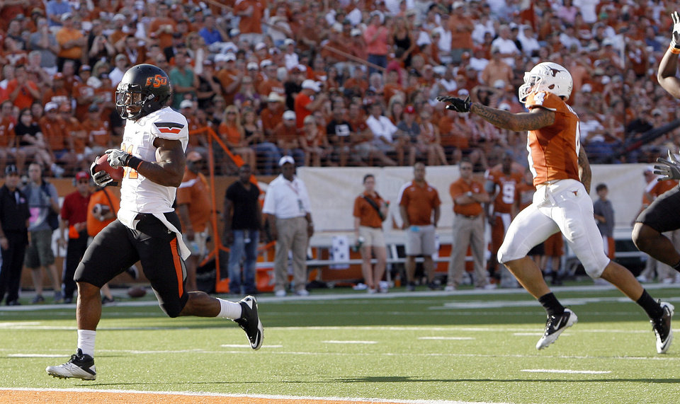 Photo - Oklahoma State's Jeremy Smith (31) scores a touchdown in front of Texas' Kenny Vaccaro (4) during second half of a college football game between the Oklahoma State University Cowboys (OSU) and the University of Texas Longhorns (UT) at Darrell K Royal-Texas Memorial Stadium in Austin, Texas, Saturday, Oct. 15, 2011. Photo by Sarah Phipps, The Oklahoman