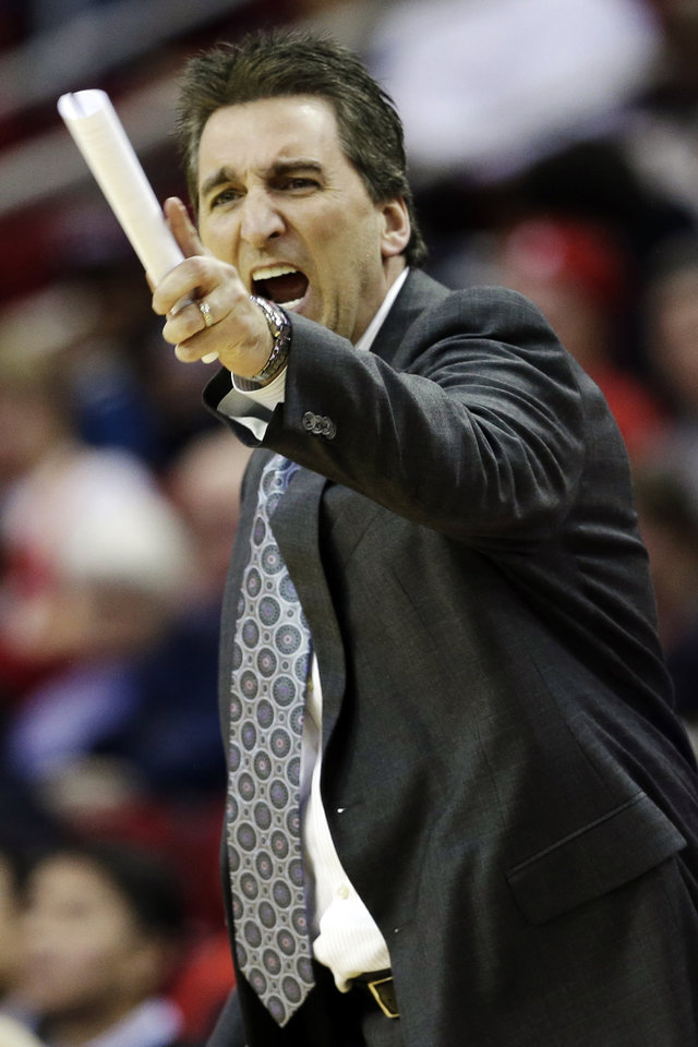 Los Angeles Clippers head coach Vinny Del Negro yells at the officials after a foul call against his team during the second quarter of an NBA basketball game against the Houston Rockets, Tuesday, Jan. 15, 2013, in Houston. Del Negro was issued a technical foul. (AP Photo/David J. Phillip)